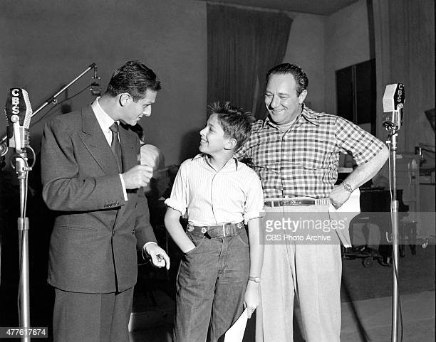 Life with Luigi a CBS Radio program From left show producer Cy Howard gives Alan Reed Jr a few pointers on his script reading while Alan Reed Sr...