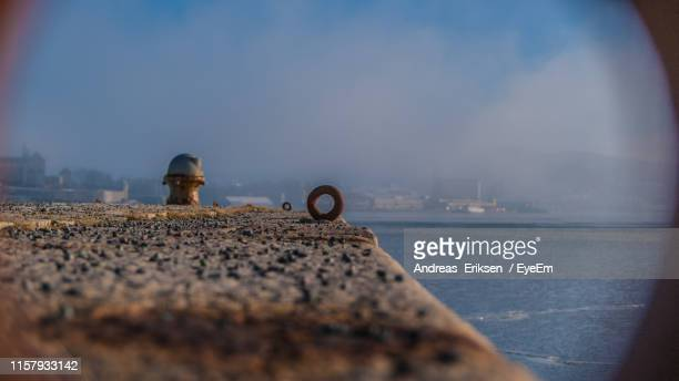 lifebelt on pier by sea - eriksen stock pictures, royalty-free photos & images