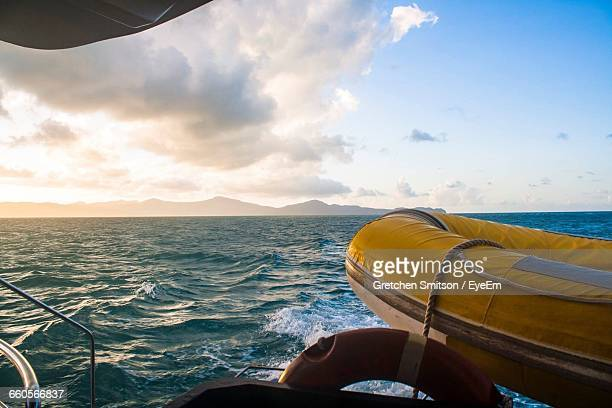 Lifeboat And Ring On Ship In Sea During Sunset