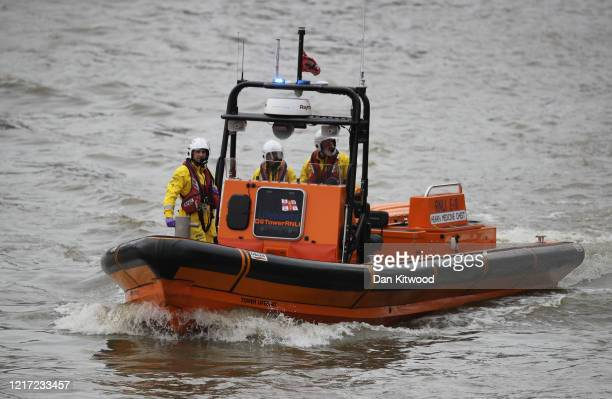 Lifeboat crew search in the Thames for a person who has been reported as falling or jumping from Westminster Bridge on June 3, 2020 in London,...