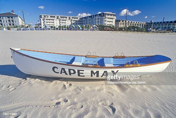 """""""lifeboat on beach in the morning, cape may, nj"""" - cape may stock pictures, royalty-free photos & images"""