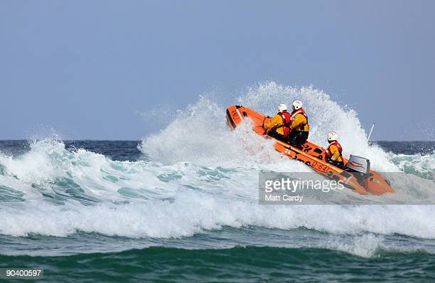 RNLI lifeboat patrols as belly boarders take part in the World Belly Boarding Championships at Chapel Porth on September 6 2009 near St Agnes England...