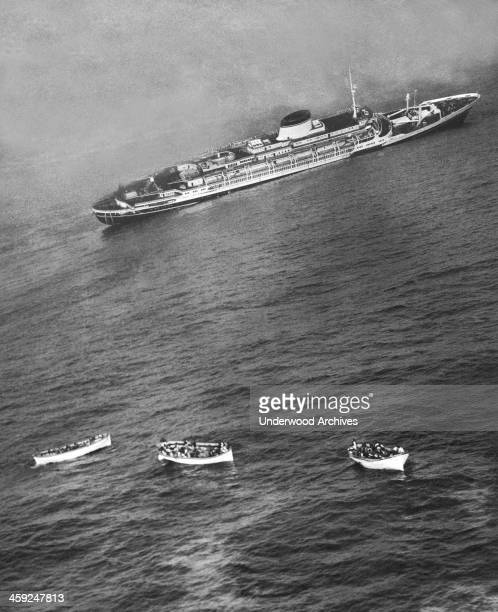 Lifeboats with passengers and crew from the Italian liner 'SS Andrea Doria' which sank shortly thereafter Nantucket Massachusetts July 26 1956 The...