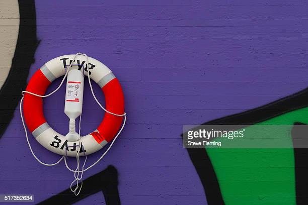 A lifebuoy attached to a colorful wall in Tromso, Norway.