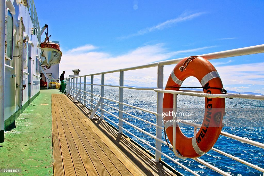 A lifebuoy on the deck of cook strait ferry : Stock Photo