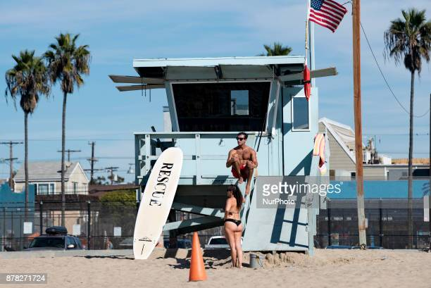 A lifeguard and a woman at Venice Beach in Los Angeles California on November 23 2017 This Thanksgiving is the hottest on record in Los Angeles By...