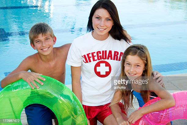 lifeguard and children - lifeguard stock pictures, royalty-free photos & images