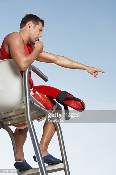 lifeguard blowing whistle - judge sports official stock pictures, royalty-free photos & images