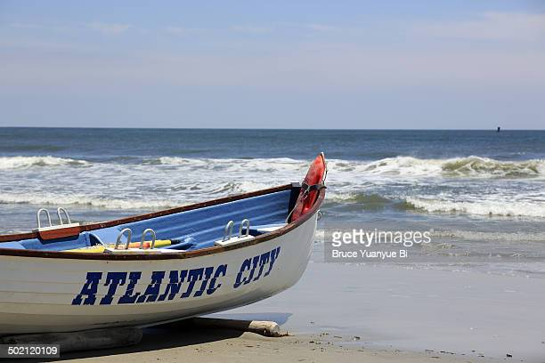 lifeguard boat on the beach - atlantic city stock pictures, royalty-free photos & images