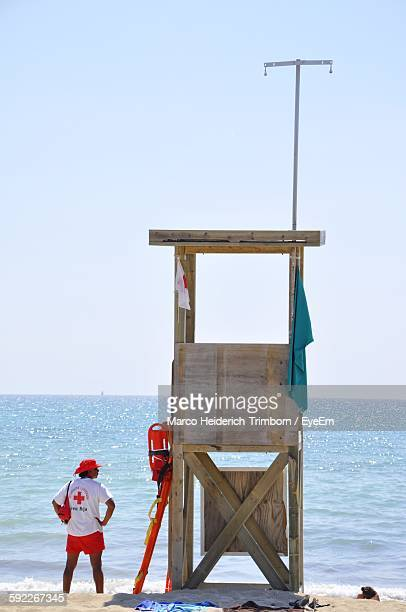 Lifeguard By Chair At Beach Against Sky