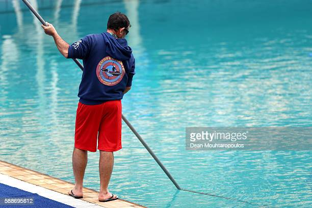 A lifeguard cleans the diving pool before the Women's Diving 3m Springboard Preliminary Round on Day 7 of the Rio 2016 Olympic Games at Maria Lenk...