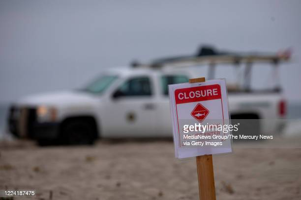 A lifeguard drives past Sand Dollar Beach in Watsonville Calif Saturday May 9 where a surfer was killed earlier in a shark attack