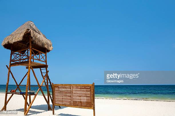 Lifeguard hut and an information board on the beach, Cancun, Mexico