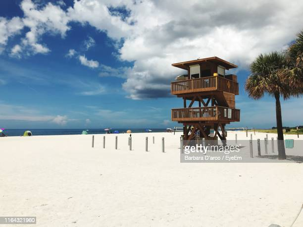 lifeguard hut at beach against cloudy sky - bradenton stock pictures, royalty-free photos & images