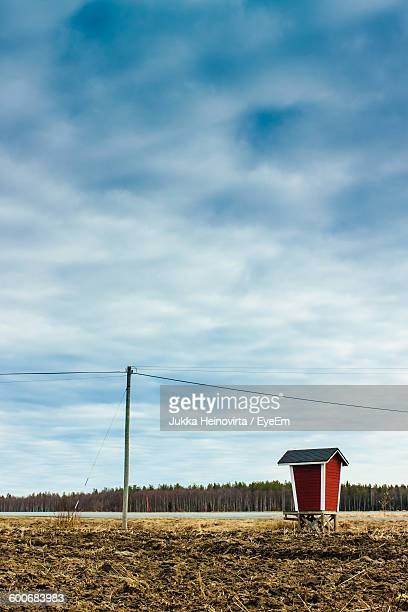 lifeguard hut at beach against cloudy sky - heinovirta stock photos and pictures