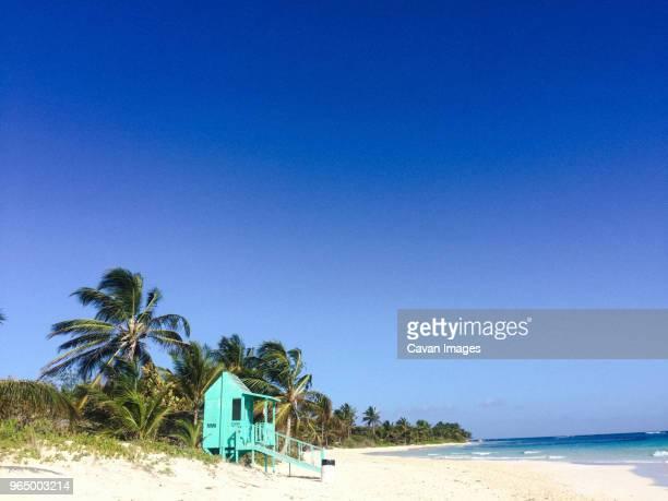 lifeguard hut at flamenco beach against clear blue sky during sunny day - paisajes de puerto rico fotografías e imágenes de stock
