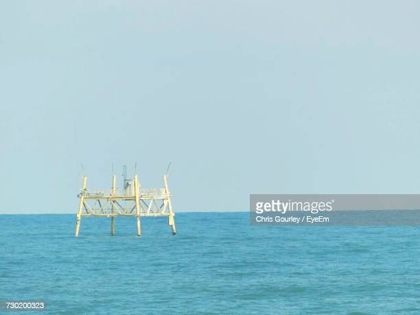 lifeguard hut in sea against clear sky - gourley stock pictures, royalty-free photos & images