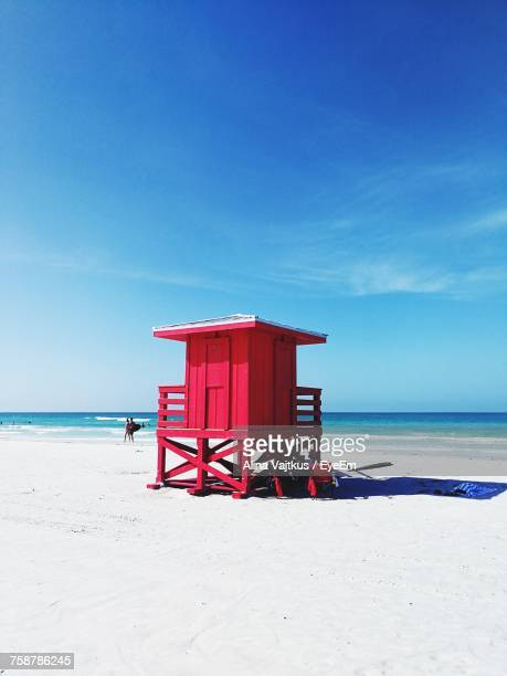 Lifeguard Hut On Beach Against Blue Sky