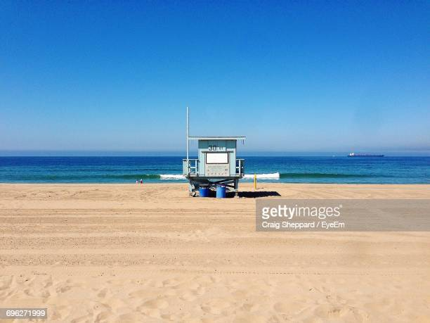 Lifeguard Hut On Beach Against Clear Blue Sky