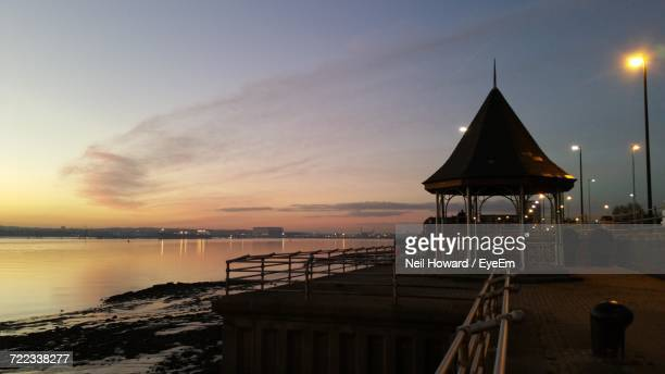 lifeguard hut on beach against sky during sunset - howard,_wisconsin stock pictures, royalty-free photos & images