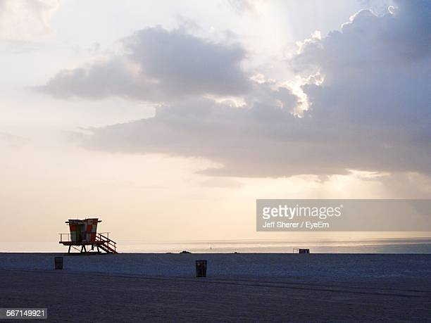 lifeguard hut on beach against sky - malibu beach stock pictures, royalty-free photos & images
