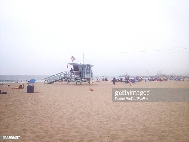 lifeguard hut on beach against sky - rachel wolfe stock pictures, royalty-free photos & images