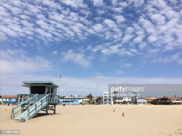lifeguard hut on beach against sky - hermosa beach stock pictures, royalty-free photos & images