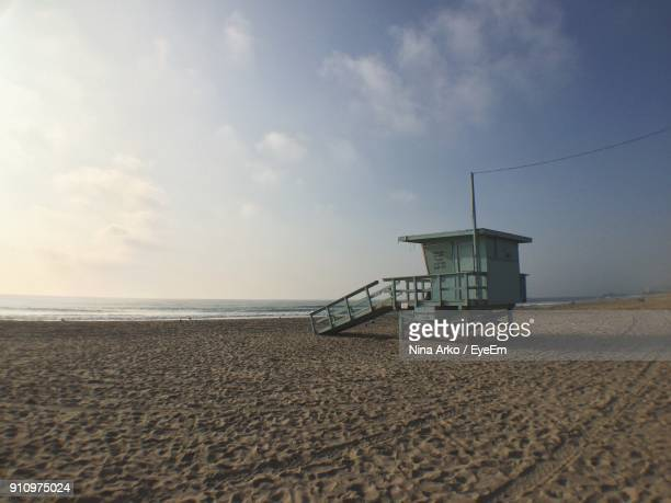 lifeguard hut on beach against sky - ca nina stock pictures, royalty-free photos & images