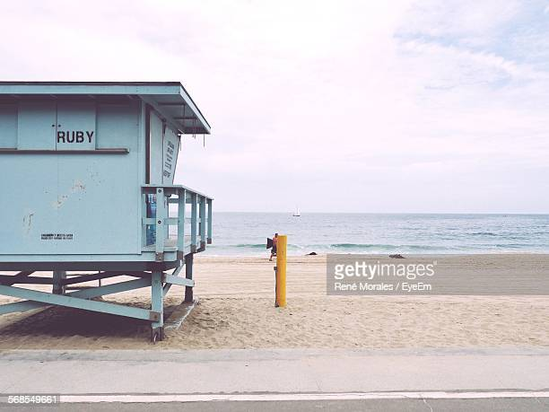 Lifeguard Hut On Beach By Sea Against Sky