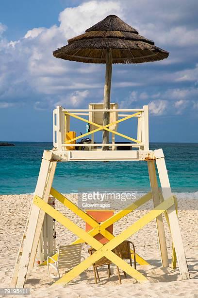 lifeguard hut on the beach, cable beach, nassau, bahamas - cable beach bahamas stock photos and pictures