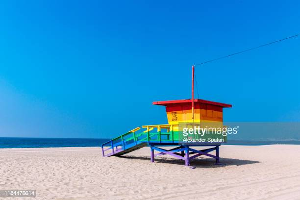 lifeguard hut painted in rainbow colors in venice beach, los angeles, california - venice california stock pictures, royalty-free photos & images