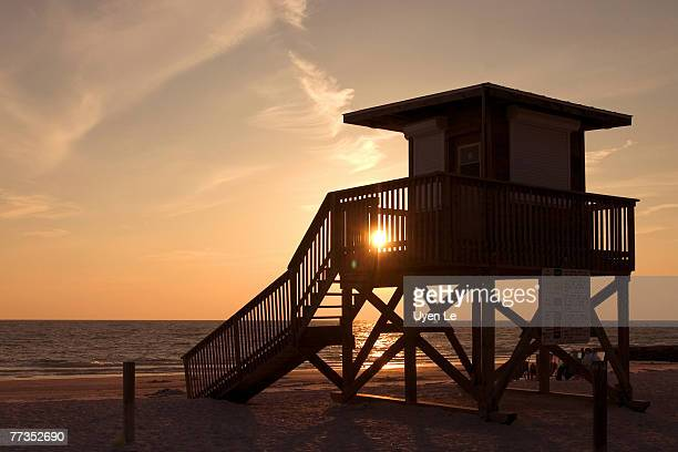 a lifeguard hut silhoutted against the sky at sunset.  coquina beach, sarasota, florida. - sarasota stock photos and pictures