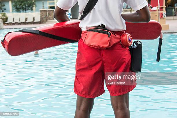 lifeguard looking out over pool - lifeguard stock pictures, royalty-free photos & images