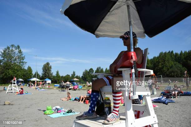 Lifeguard Luke Orot from Anchorage watches on at Jewel Lake on July 4 2019 in Anchorage Alaska Alaska is bracing for record warm temperatures and dry...