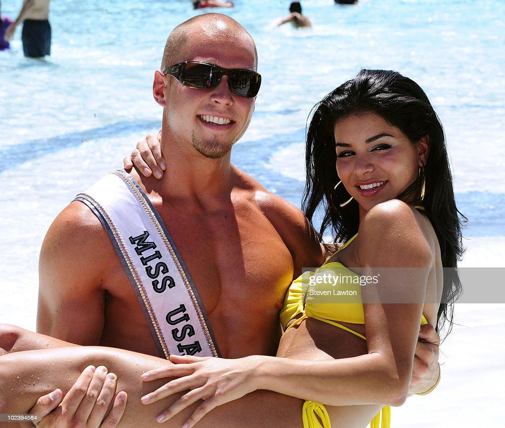 Lifeguard Mike Lukowski holds up Miss USA 2010, Rima Fakih at the Mandalay Bay Beach on June 24, 2010 in Las Vegas, Nevada.