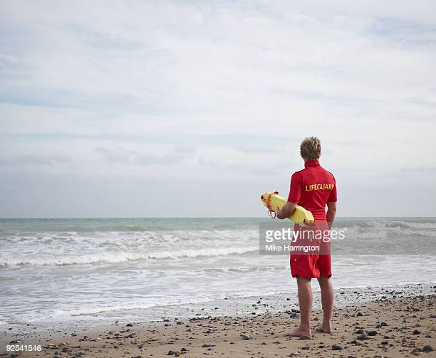 Lifeguard on Beach looking at the sea