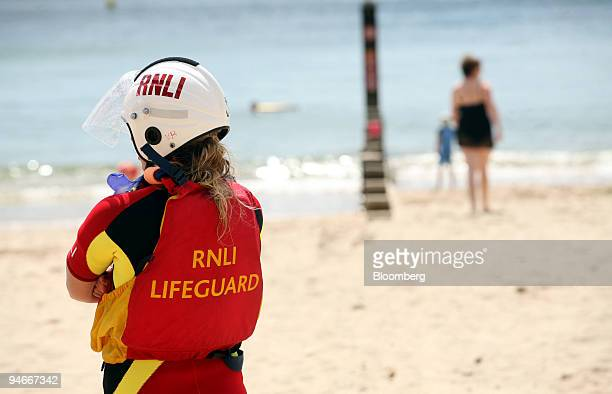 A lifeguard on patrol on the beach at Bournemouth Dorset UK Monday July 30 2007