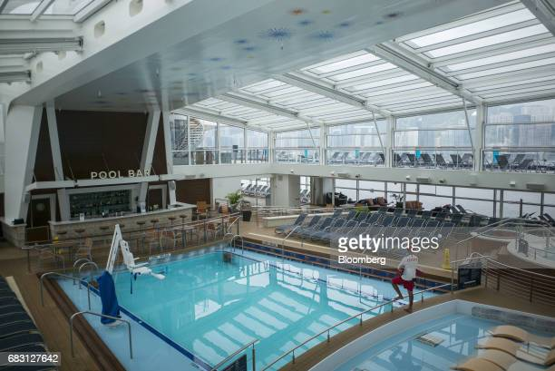 A lifeguard overlooks an empty swimming pool on board the Ovation of the Seas Quantumclass cruise ship operated by Royal Caribbean Cruises Ltd at the...