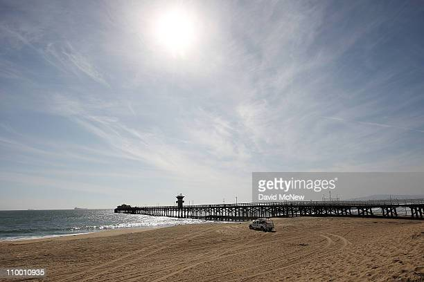A lifeguard patrols Seal Beach which was closed by authorities as a precaution against a possible tsunami following a massive earthquake in Japan...