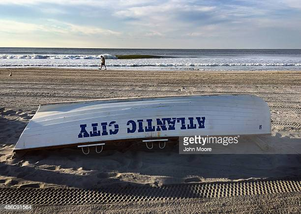 A lifeguard rescue boat lies on the beach on August 27 2015 in Atlantic City New Jersey New casinos in neighboring states have drawn much of Atlantic...