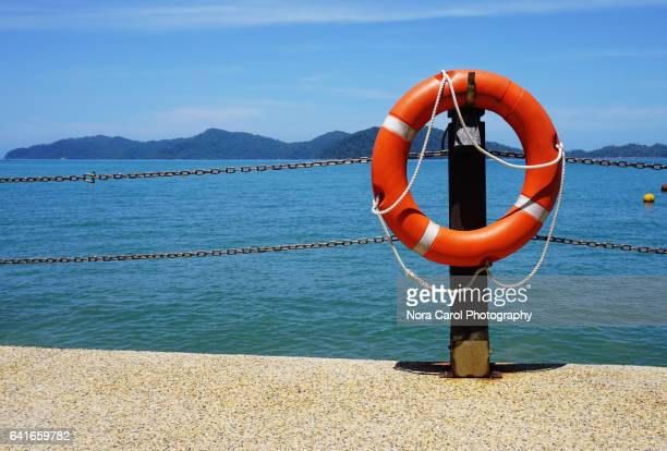 lifeguard ring buoys - kota kinabalu stock pictures, royalty-free photos & images