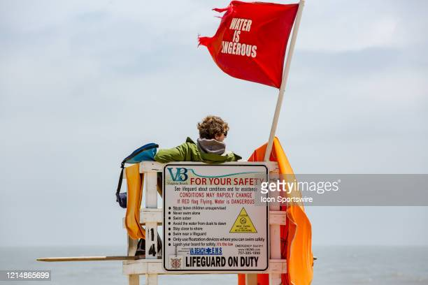 A lifeguard settles in near Virginia Beach Fishing Pier to kick off Memorial Day weekend A red flag is flown to indicate that the water is dangerous...
