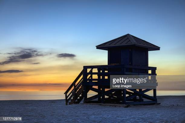 Lifeguard shack at sunset at Siesta Key Beach in Florida.