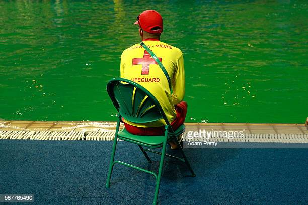 A lifeguard sits by the edge of the diving pool at Maria Lenk Aquatics Centre on Day 4 of the Rio 2016 Olympic Games at Maria Lenk Aquatics Centre on...