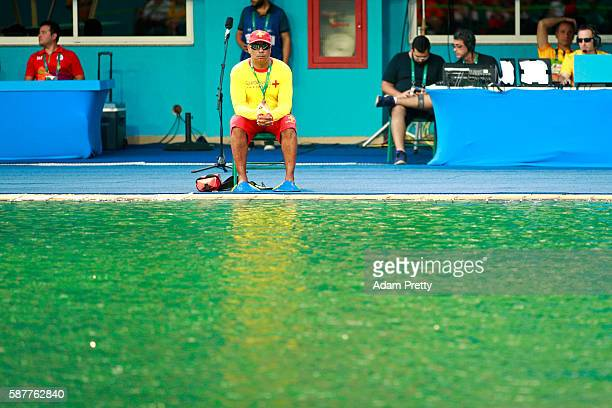 A lifeguard sits by the edge of the diving pool during the Women's Diving Synchronised 10m Platform Final on Day 4 of the Rio 2016 Olympic Games at...