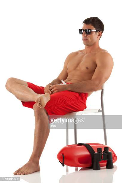Lifeguard sitting on chair