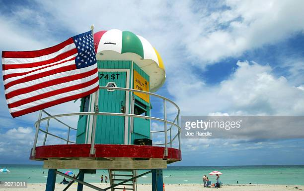A lifeguard stand with a US flag is shown on the beach June 10 2003 in North Miami Florida According to the Pew Oceans Commission report released...