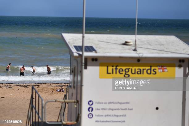 A lifeguard station oversees the beach as people swim in the water at Viking Bay in Broadstairs southeast England on May 28 during the COVID19...