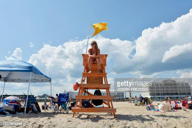 A lifeguard surveys the water at Hampton Beach in Hampton New Hampshire on August 5 as COVID19 cases in New England are on the rise Hampton Beach is...