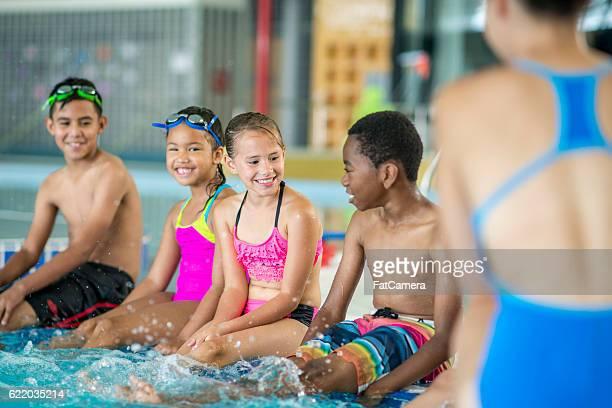 Lifeguard Teaching a Swim Class